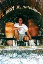 Paul at the kiln at Millstone Pottery, McGregor